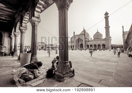 JAMA MASJID OLD DELHI INDIA - 24 JUNE 2017 : Indian ladies devotees doing prayer as they celebrate the last Friday before Eid. The evening is named