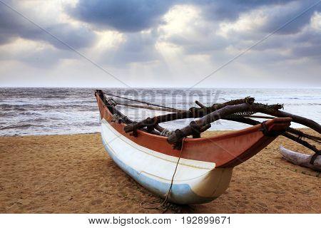 Fishing boat on a deserted coast. Sri Lanka (Ceylon)