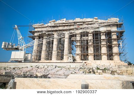 The Parthenon is under reconstruction. Ancient Greek temple Parthenon in Athens Greece on a clear day against the blue sky