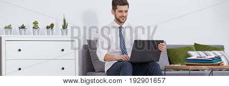 House room with man working using the laptop