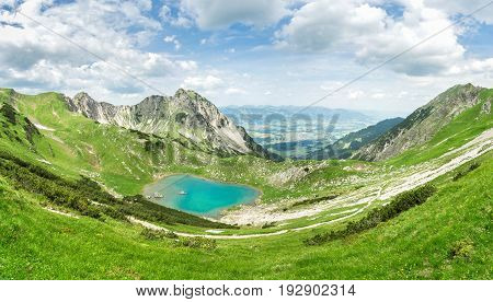 Remote Gaisalpsee lake up high in the alpine mountains in spring or summer. Bavaria, Allgau, Germany.