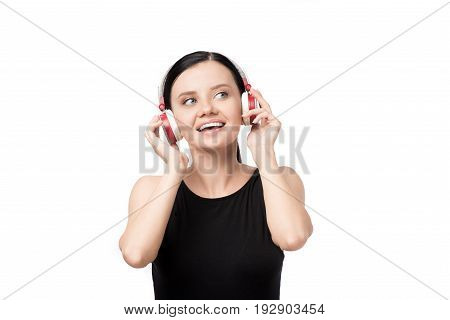 Happy Young Woman Listening Music In Headphones Isolated On White