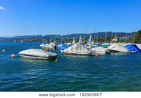 Zurich, Switzerland - 18 June, 2017: boats on Lake Zurich, view from the city of Zurich. Lake Zurich is a lake in Switzerland, extending southeast of the city of Zurich, which is the largest city in Switzerland.
