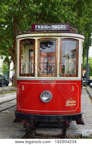 SINTRA PORTUGAL - June 12 2017: Vintage red tram shown on the streets of Sintra. Old trams are one from a lot of tourist attraction in Sintra