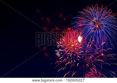 Beautiful Colorful Fireworks On Sky. Fireworks Display On Dark Sky Background. Independence Day, 4Th