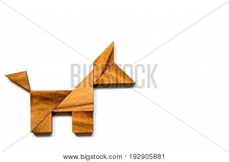 Wooden tangram puzzle in dog shape on white background