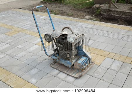 Concrete brick pavement finishing with vibratory plate compactor