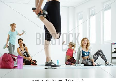 Girls warming up before fitness classes on a gym