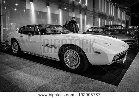 MAASTRICHT NETHERLANDS - JANUARY 14 2016: Grand tourer car Maserati Ghibli I 1967. Black and white. International Exhibition InterClassics & Topmobiel 2016