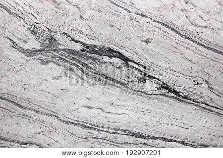 Monochrome marble texture. White background with dark streacks