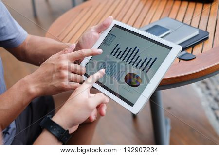 close up asian business man meeting together for consulting stock market statistics concept,pointing finer on touchscreen for discuss on dashboard concept