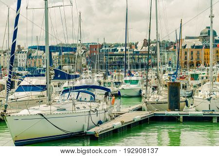 Yachts moored at quay port of Dieppe France. Concepts of success leisure holiday rich tourism luxury lifestyle. Sunny