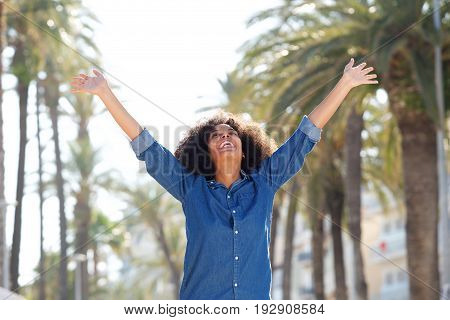 Happy Carefree Woman With Arms Outstretched Outside