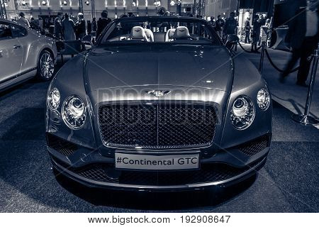 MAASTRICHT NETHERLANDS - JANUARY 14 2016: Luxury car Bentley Continental GTC V8S since 2016. Toning. International Exhibition InterClassics & Topmobiel 2016