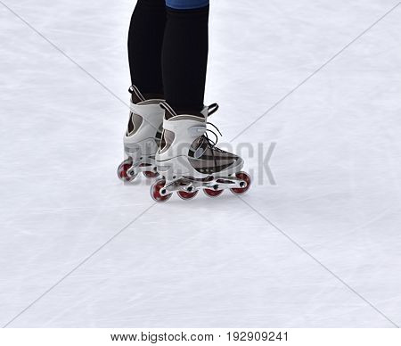 Person inline skating on ice - unrecognizable