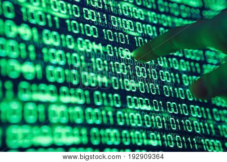 Programming, binary system code, programmer, program, computer, monitor, screen.