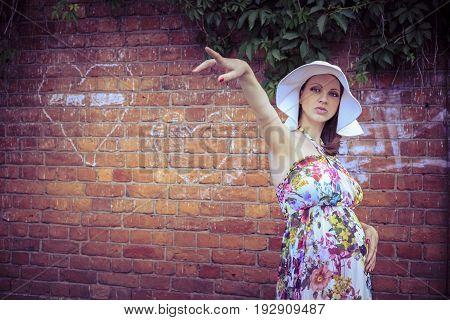 Pregnant woman indicates direction (Saint Petersburg, Russia)