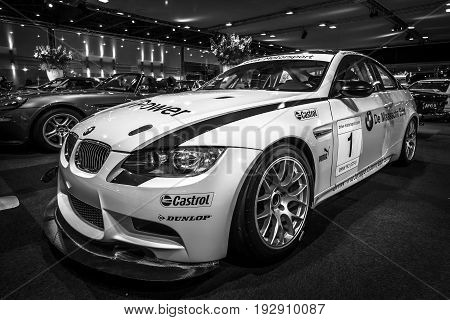 MAASTRICHT NETHERLANDS - JANUARY 14 2016: Sports car BMW M3 GT4 2009. Black and white. International Exhibition InterClassics & Topmobiel 2016