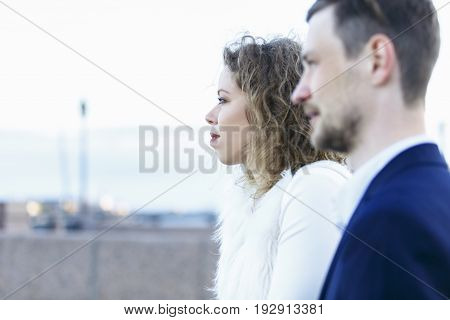 Evening walk of a lady with her young man