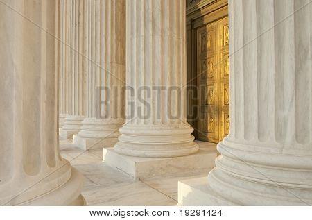 Supreme Court Column Details. Sunset orange light cast across scene.