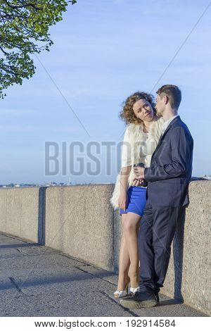 Young couple on a walk in the spring city (Saint Petersburg, Russia)