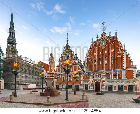 Hall town square with state public museums and Saint Peter church in Riga - capital city of Latvia, major cultural, historical and tourist center of Baltic region. Image toned for retro style