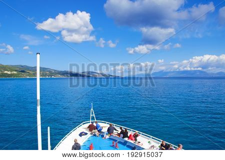 SEA, GREECE - May 15, 2014: tourists on the top deck of ship sailing from Zakynthos island.   people (big group) on the deck of a ship, Greece