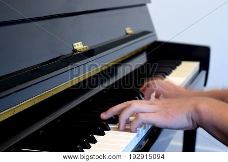 The Blurred Look at the Hands of a Pianist.