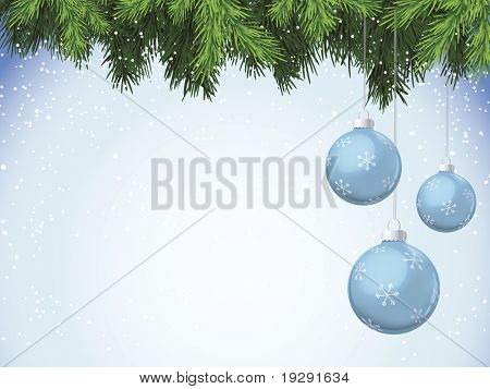 Evergreen branches with blue Christmas ornaments