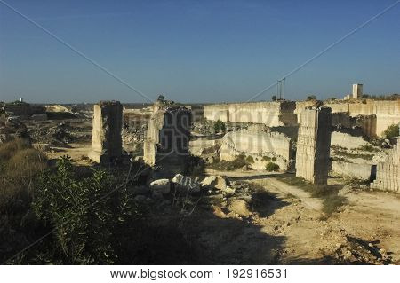 View of abandoned limestone quarry in Apulia