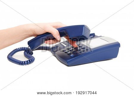 hand holding phone receiver and dialing number