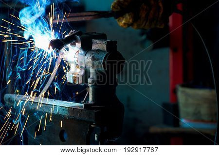 Welding process for metal close-up. Industrial concept