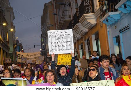 QUITO, ECUADOR- MAY 06, 2017: Crowd of people holding a sign during a protest with the slogan alive we want them, protest against the femicide in Quito Ecuador.