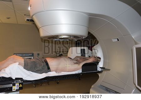 Patient Radiation therapy showing laser lines for targeting cancer cells in the brain and Throat