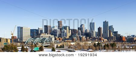 Denver Colorado city skyline from west side of town. Snow covered ground winter.