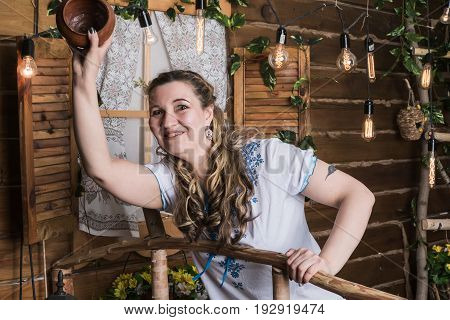 Ugly Woman In National Dress Posing In A Rustic Interior