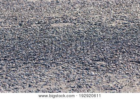 Old black asphalt on the road as background