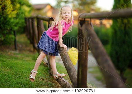 Cute Little Girl Having Fun In Lonato Del Garda, A Small Town And Comune In The Province Of Brescia,