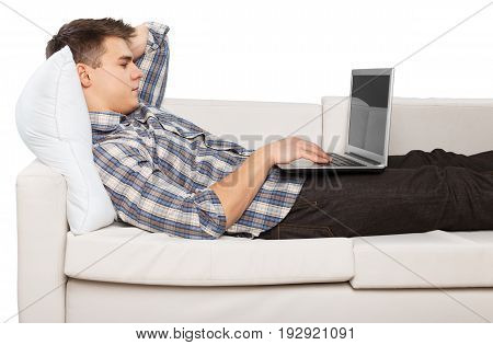 Young portrait man laptop sofa white computer