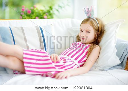 Portrait Of Adorable Little Girl Wearing A Dress And A Princess Tiara