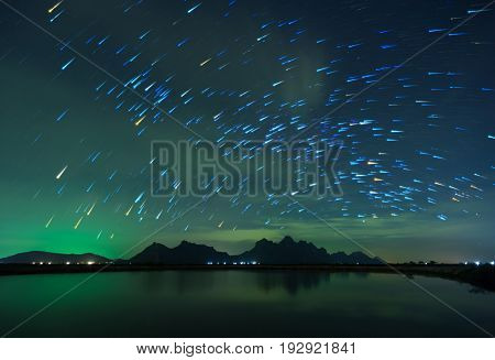 Beautiful Night Starry sky with Rising star trail over the mountain Thailand