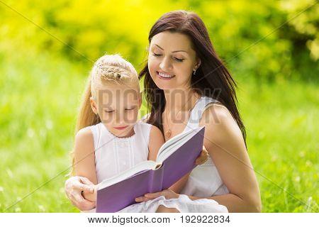 Reading family child girl mother kid daughter