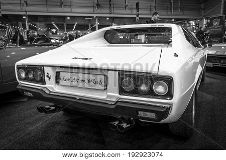 MAASTRICHT NETHERLANDS - JANUARY 14 2016: Sports car Ferrari 308 GT4 Dino 1977. Rear view. Black and white. International Exhibition InterClassics & Topmobiel 2016