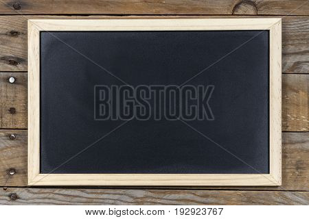 Space chalkboard background texture with wooden frame with space to write. blackboard space for wallpaper. Landscape mounting style horizontal.