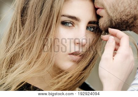 Cute Girl With Sensual Kiss Of Male Lips