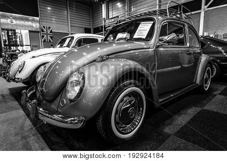 MAASTRICHT NETHERLANDS - JANUARY 14 2016: Subcompact Volkswagen Beetle 1971. Black and white. International Exhibition InterClassics & Topmobiel 2016