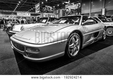 MAASTRICHT NETHERLANDS - JANUARY 14 2016: Sports car Ferrari F355 GTS 1998. Blacl and white. International Exhibition InterClassics & Topmobiel 2016