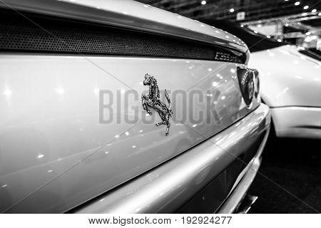 MAASTRICHT NETHERLANDS - JANUARY 14 2016: Detail of sports car Ferrari F355 GTS 1998. Black and white. International Exhibition InterClassics & Topmobiel 2016