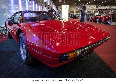 MAASTRICHT NETHERLANDS - JANUARY 14 2016: Sports car Ferrari 308 GTB Quattrovalvole 1983. International Exhibition InterClassics & Topmobiel 2016