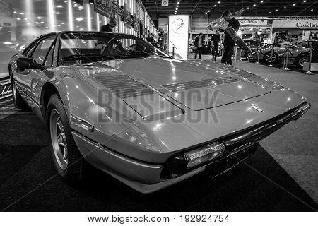 MAASTRICHT NETHERLANDS - JANUARY 14 2016: Sports car Ferrari 308 GTB Quattrovalvole 1983. Black and white. International Exhibition InterClassics & Topmobiel 2016